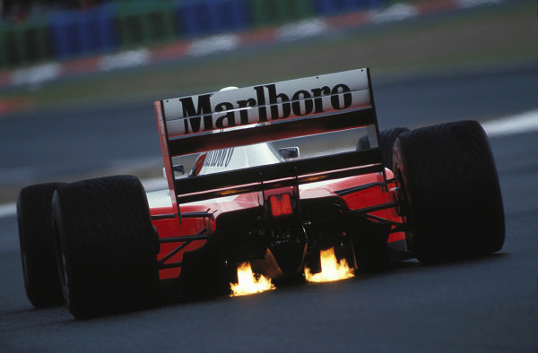 Ayrton Senna, McLaren MP4-7A Honda, with exhaust flames.