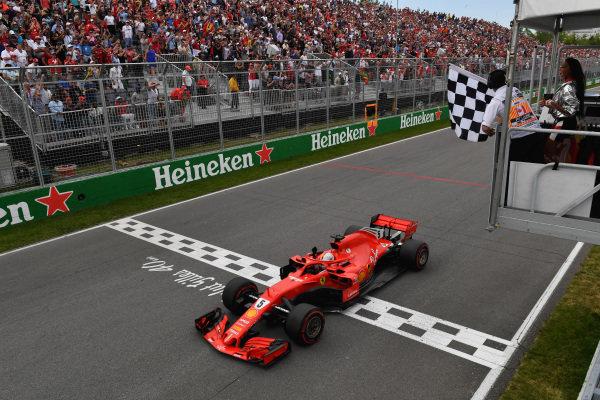 Race winner Sebastian Vettel (GER) Ferrari SF-71H takes the chequered flag
