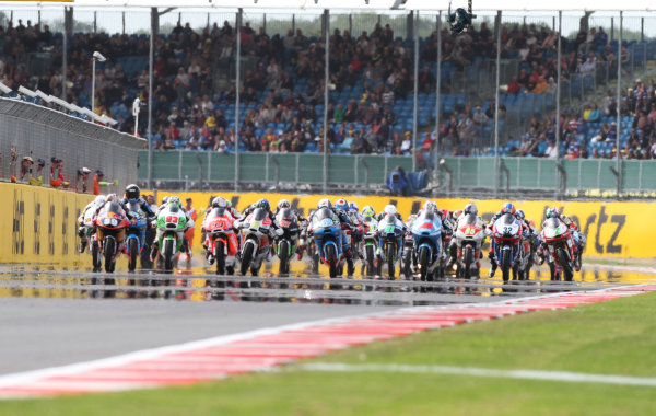 British Grand Prix.  Silverstone, England. 30th August - 1st September 2013.  Luis Salom, KTM, Alex Rins, KTM, and Maverick Vinales, KTM, lead off the front row at the start.  Ref: IMG_2609a. World copyright: Kevin Wood/LAT Photographic