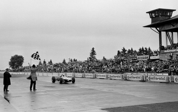 Jack Brabham (AUS) Brabham BT19 takes the chequered flag to win his fourth Grand Prix in a row. German Grand Prix, Nurburgring, 7 August 1966.