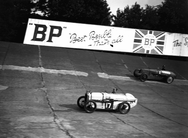 Brooklands, Great Britain. September 1927.  J S H Wilson (#17 Austin Seven), leads John R Cobb (#2 Vauxhall), in the 50 Miles Handicap race, action World Copyright: LAT Photographic Ref:  Autocar Glass Plate A8623.