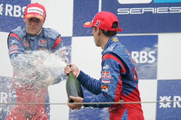 Magny-Cours, France. 22nd June.Sunday Race. Sebastien Buemi (SUI, Trust Team Arden) celebrates his victory on the podium with Yelmer Buurman (NED, Trust Team Arden). World Copyright: Alastair Staley/GP2 Series Media Service.ref: Digital Image _MG_3561