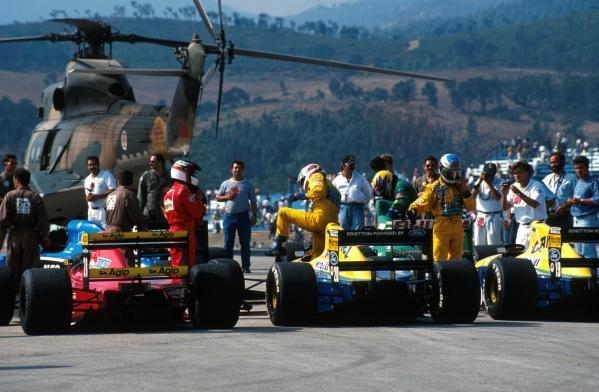 Jean Alesi (FRA ) Ferrari 643  3rd, Nelson Piquet (BRA) Benetton Ford B191, 5th place and Michael Schumacher (GER) Benetton Ford B191 6th place in parc ferme after the racePortuguese Grand Prix, Estoril, 22 September 1991