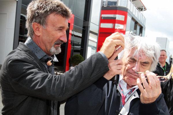 (L to R): Eddie Jordan (IRE) BBC Television Pundit with Bernie Ecclestone (GBR) CEO Formula One Group (FOM). Formula One World Championship, Rd 9, British Grand Prix, Qualifying Day, Silverstone, England, Saturday 9 July 2011.