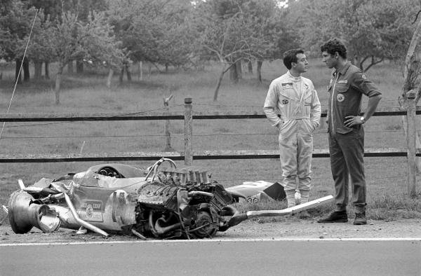 Jackie Oliver (GBR) (left) and a Lotus mechanic wonder how Jackie was able to walk away from the Lotus 49B after a violent accident in practice.  