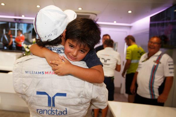 Autodromo Nazionale di Monza, Monza, Italy. Sunday 7 September 2014. Felipe Massa, Williams F1, 3rd Position, celebrates with his son. World Copyright: Glenn Dunbar/LAT Photographic. ref: Digital Image _W2Q0808