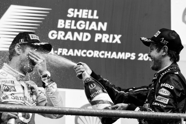 (L to R): Third placed Jenson Button (GBR) McLaren and race winner Sebastian Vettel (GER) Red Bull Racing celebrate on the podium. Formula One World Championship, Rd 12, Belgian Grand Prix, Race, Spa-Francorchamps, Belgium, Sunday 28 August 2011.Note: This image has been digitally altered from the original, which is also available on the archive. (d11bel1292.jpg).