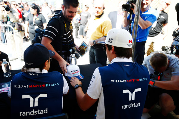 Circuit Gilles Villeneuve, Montreal, Canada. Thursday 08 June 2017. Lance Stroll, Williams Martini Racing, and Felipe Massa, Williams Martini Racing, sign autographs for fans. World Copyright: Andy Hone/LAT Images ref: Digital Image _ONZ9896
