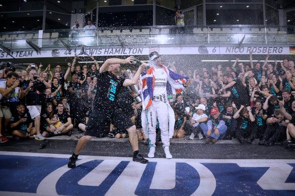 Yas Marina Circuit, Abu Dhabi, United Arab Emirates. Sunday 23 November 2014.  Lewis Hamilton and the Mercedes team celebrate championship victory.  World Copyright: Steve Etherington/LAT Photographic. ref: Digital Image SNE22530