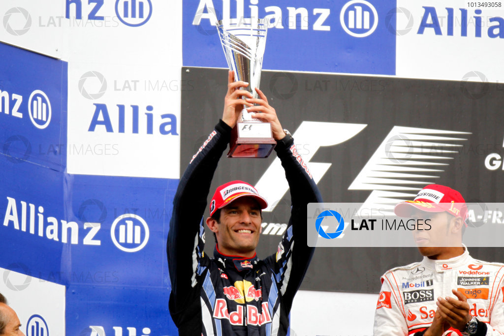 Spa-Francorchamps, Spa, Belgium 29th August 2010 Mark Webber, Red Bull Racing RB6 Renault, 2nd position, lifts his trophy. Portrait. Podium.  World Copyright: Charles Coates/LAT Photographic ref: Digital Image _G7C0670