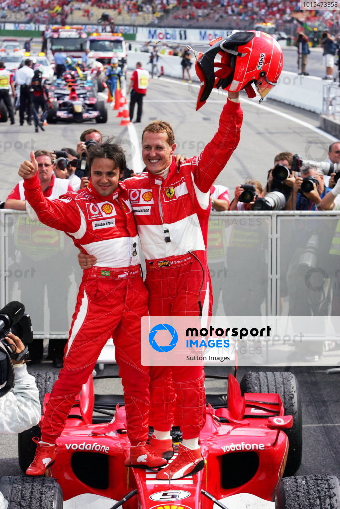 Race winner Michael Schumacher (GER) Ferrari (Right) and second placed team mate celebrate in parc ferme.