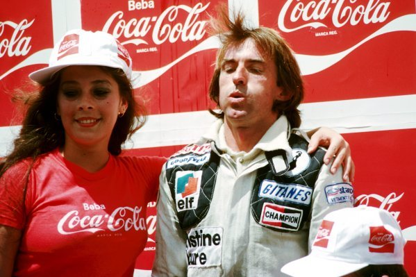 Race winner Jacques Laffite (FRA) Ligier takes a deep breath on the podium as he is aided by a Coca-Cola girl. Brazilian Grand Prix, Rd 2, Interlagos, Brazil, 4 February 1979. BEST IMAGE