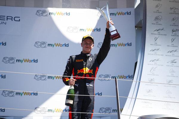 Juri Vips (EST) Hitech Grand Prix, celebrates on the podium