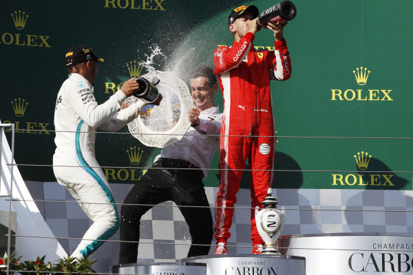 Lewis Hamilton (GBR) Mercedes-AMG F1 and Sebastian Vettel (GER) Ferrari celebrate with the champagne on the podium
