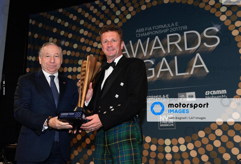 Jean Todt, FIA President, presents Allan McNish, Team Principal, Audi Sport Abt Schaeffler, with the winning team trophy.