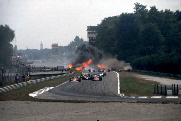 The crash at the start in which Ronnie Peterson lost his life. Gilles Villeneuve, Ferrari 312T3, Niki Lauda, Brabham BT46 Alfa Romeo, and Mario Andretti, Lotus 79 Ford, lead as the accident takes place behind them.