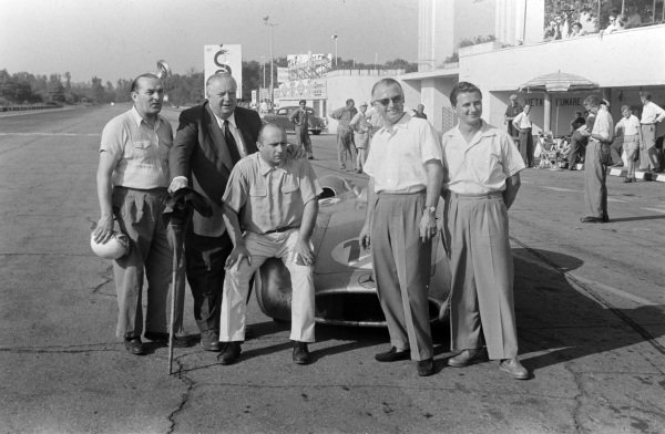 Hermann Lang, Alfred Neubauer and Juan Manuel Fangio with Fangio's Mercedes W196.