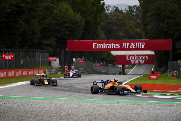 Lando Norris, McLaren MCL34, leads Alexander Albon, Red Bull RB15, and Sergio Perez, Racing Point RP19