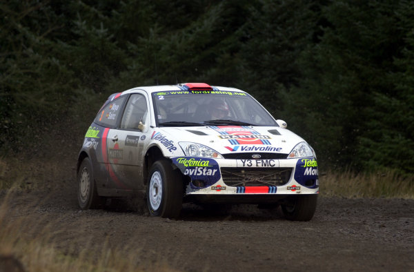 2001 FIA World Rally Championship.Rally of Great Britain. Cardiff, Wales. November 22-25, 2001.Carlos Sainz on Stage 3 - Tyle, showing damage from a puncture on Stage 2.Photo: Ralph Hardwick/LAT