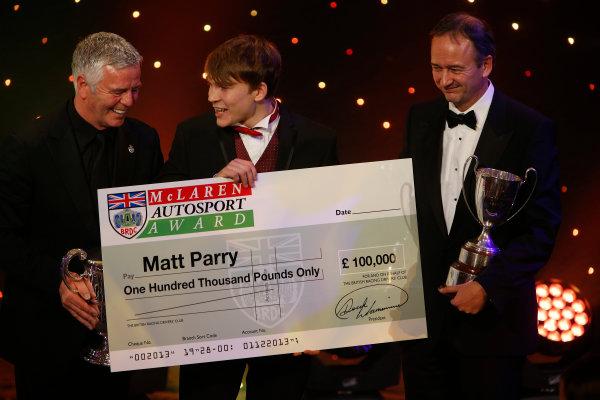 2013 Autosport Awards. Grosvenor House Hotel, Park Lane, London. Sunday 1st December 2013. Matt Parry, wins 2013 McLaren Autosport BRDC Award, and receives cheque for £100,000 World Copyright: Glenn Dunbar/LAT Photographic. ref: Digital Image _89P7641
