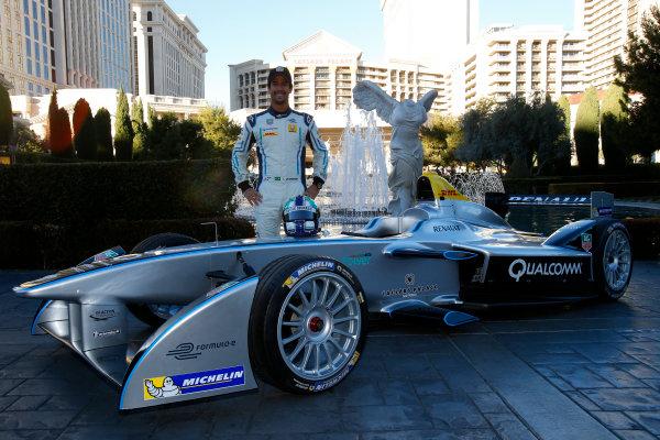 5-6 January, 2014, Las Vegas, Nevada USA Former F1 driver Lucas di Grassi poses with the new Spark-Renault SRT_01E Formula E car ©2014, Lesley Ann Miller LAT Photo USA