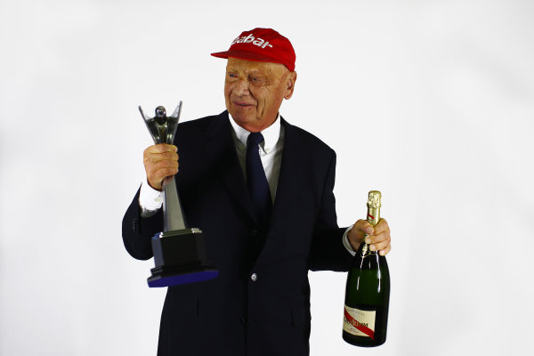 2013 Autosport Awards. Grosvenor House Hotel, Park Lane, London. Sunday 1st December 2013. Niki Lauda with his Gregor Grant Award and bottle of Mumm Champagne. World Copyright: Malcolm Griffiths/LAT Photographic. ref: Digital Image F80P1935