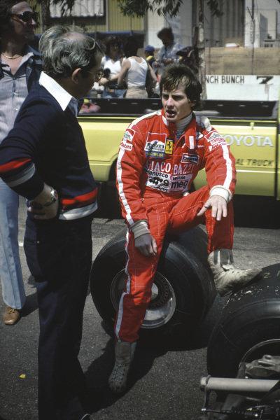Long Beach, California, USA. 6 - 8 April 1979.Gilles Villeneuve (Ferrari 312T4) 1st position, relaxes in the pits, portrait.World Copyright: LAT Photographic.Ref: 79LB28