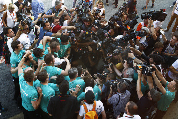 Circuit de Catalunya, Barcelona, Spain. Sunday 10 May 2015. Nico Rosberg, Mercedes AMG, 1st Position, celebrates victory with his team. World Copyright: Sam Bloxham/LAT Photographic. ref: Digital Image _G7C5024