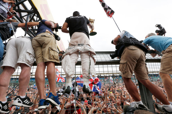 Silverstone Circuit, Northamptonshire, England. Sunday 5 July 2015. Lewis Hamilton, Mercedes AMG, 1st Position, shows his trophy to the crowds. World Copyright: Alastair Staley/LAT Photographic ref: Digital Image _79P4012