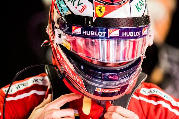 Autodromo Nazionale di Monza, Italy. Saturday 2 September 2017. Kimi Raikkonen, Ferrari, puts on his helmet. World Copyright: Sam Bloxham/LAT Images  ref: Digital Image _W6I3839