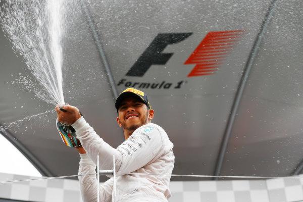 Circuit Gilles Villeneuve, Montreal, Canada. Sunday 12 June 2016. Lewis Hamilton, Mercedes AMG, 1st Position, sprays Champagne on the podium. World Copyright: Steven Tee/LAT Photographic ref: Digital Image _H7I5991