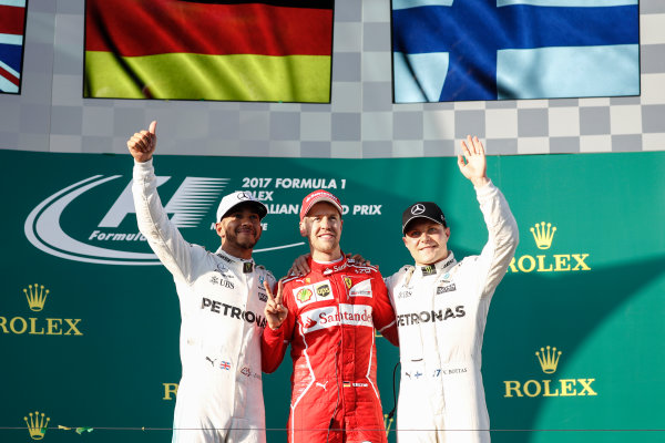 Albert Park, Melbourne, Australia. Sunday 26 March 2017. Lewis Hamilton, Mercedes AMG, 2nd Position, Sebastian Vettel, Ferrari, 1st Position, and Valtteri Bottas, Mercedes AMG, 3rd Position, on the podium. World Copyright: Glenn Dunbar/LAT Images ref: Digital Image _X4I4221