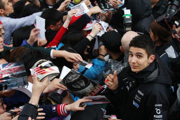 Shanghai International Circuit, Shanghai, China.  Thursday 06 April 2017.  Esteban Ocon, Force India, signs autographs for fans. World Copyright: Charles Coates/LAT Images  ref: Digital Image GJ9R7529