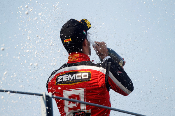 Autodromo Nazionale di Monza, Monza, Italy. Sunday 9th September 2012. Sunday Race 2.Race 2 winner Tio Ellinas (CYP, Marussia Manor Racing) celebrates on the podium. Portrait. World Copyright: Andrew Ferraro/LAT Photographic Ref: Digital Image _Q0C6291.jpg