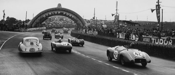 Le Mans, France. 23rd - 24th June 1951 R to L: Bert Hadley/Charles Goodacre (#42 Jowett Jupiter), retired, follows Pierre Veyron/Georges Monneret (#37 Simca Gordini), retired, Auguste Veuillet/Edmond Mouche (#46 Porsche 356/4), 20th position and Richard Stoop/Peter S. Wilson (#34 Frazer Nash RLM), 19th position, at the start, action. World Copyright: LAT Photographic Ref:  B/W Print