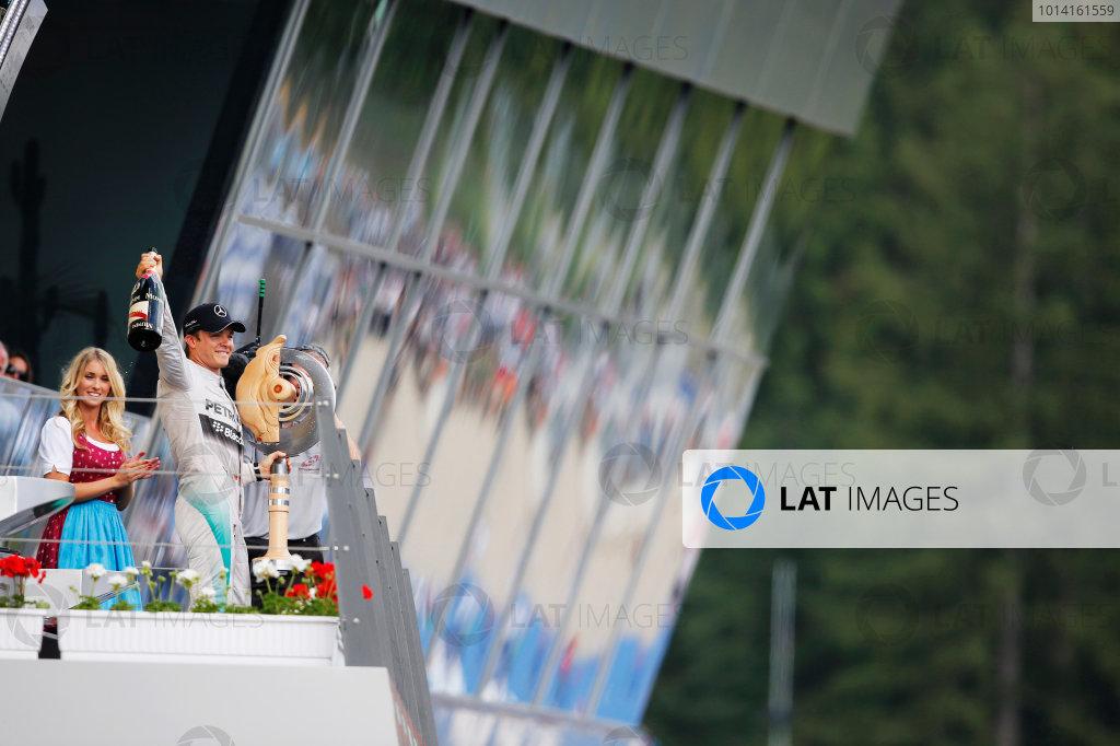 Red Bull Ring, Spielberg, Austria. Sunday 22 June 2014. Nico Rosberg, Mercedes AMG, 1st Position, celebrates on the podium. World Copyright: Steven Tee/LAT Photographic. ref: Digital Image _X0W0952