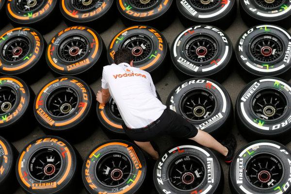 Circuit de Catalunya, Barcelona, Spain 10th May 2013 A McLaren mechanic marks up some tyres. World Copyright: Steven Tee/LAT Photographic ref: Digital Image _L0U0058