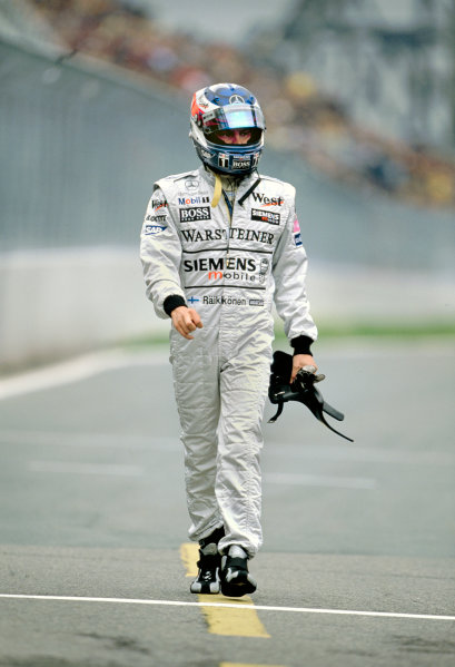 2003 Canadian Grand PrixMontreal, Canada. 13th - 15th June 2003.Kimi Raikkonen, Team McLaren Mercedes MP4-17D, walks back to the pits, after crashing in qualifying.World Copyright: Lorenzo Bellanca / LAT Photographic ref: 35mm Image 03Canada04
