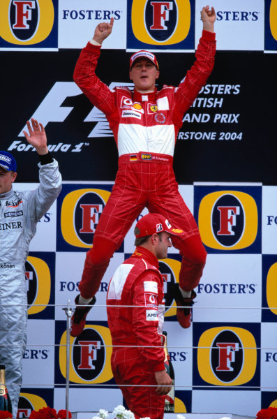 2004 British Grand Prix Silverstone England. 9th - 11th July. Michael Schumacher, Ferrari F2004 celebtartes his win with his victory leap. World Copyright:Peter Spinney/LAT Photographic  Ref:35mm image A22