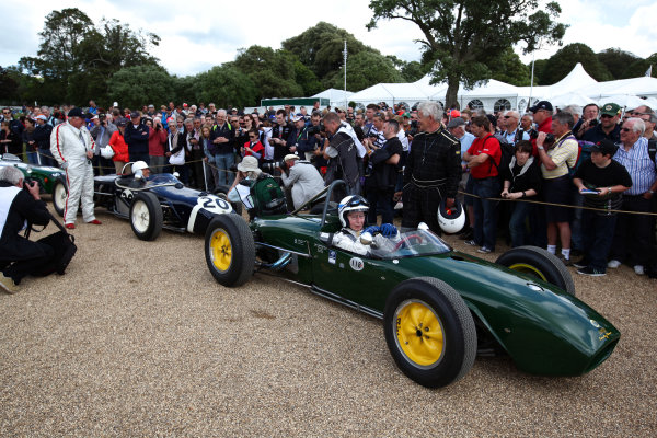2012 Goodwood Festival of Speed. Goodwood Estate, West Sussex, England. 28th June - 1st July 2012. John Surtees with Stirling Moss just behind, action.  World Copyright: Daniel Kalisz/LAT Photographic. ref: Digital Image Only.
