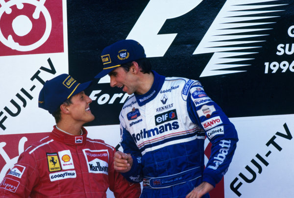 Suzuka, Japan.11-13 October 1996.Damon Hill (Williams Renault) 1st position, makes a point of telling Michael Schumacher (Ferrari) 2nd position that he is the new World Champion. Podium.World Copyright - LAT Photographic