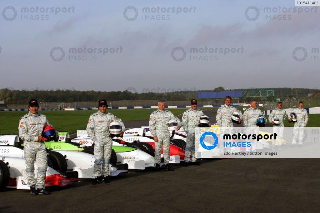 (L-R): Emerson Fittipaldi (BRA), Andrea de Cesaris (ITA), Derek Warwick (GBR), Nigel Mansell (GBR), Christian Danner (GER), Patrick Tambay (FRA), Riccardo Patrese (ITA) and Stefan Johansson (SWE). Grand Prix Masters Testing, Day One, Silverstone, England, 26 October 2005. DIGITAL IMAGE