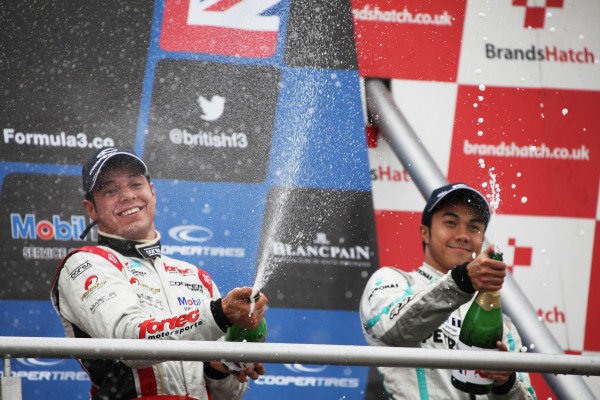 Brands Hatch, Kent. 10th - 11th August 2013.  Felipe Guimaraes, Fortec, and Jazeman Jaafar, Carlin, celebrate on the podium.  Ref: IMG_3365a. World Copyright: Kevin Wood/LAT Photographic