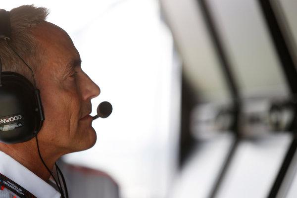 Buddh International Circuit, New Delhi, India. Friday 25th October 2013. Martin Whitmarsh, Team Principal, McLaren, on the pit wall. World Copyright: Charles Coates/LAT Photographic. ref: Digital Image _N7T0075