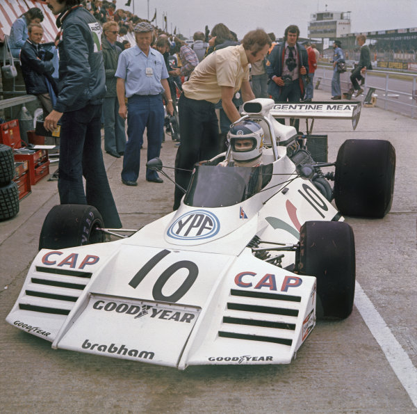 Silverstone, England.12-14 July 1973.Carlos Reutemann (Brabham BT42 Ford) 6th position, pit lane action.World Copyright - LAT Photographic.ref: Colour transparency.