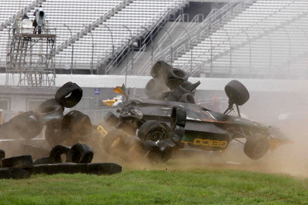 11-14 August, 2011, Loudon, New Hampshire USA EDITORIAL USAGE ONLY!!! After colliding with Tomas Scheckter, Tony Kanaan hits a tire wall and flips upside down (c)2011, HHP/Gregg Ellman LAT Photo USA