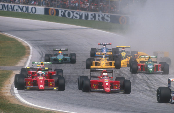 1990 San Marino Grand Prix.Imola, Italy.11-13 May 1990.Nigel Mansell and Alain Prost (both Ferrari 641's) side by side going into Tosa on the first lap at the start. Behind Martin Donnelly (Lotus 102 Lamborghini) has a wild spin amongst the others. Ref-90 SM 07.World Copyright - LAT Photographic