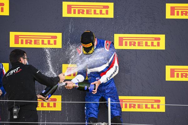 Race winner Alexander Smolvar (RUS, ART GRAND PRIX) celebrates on the podium with the chmapagne