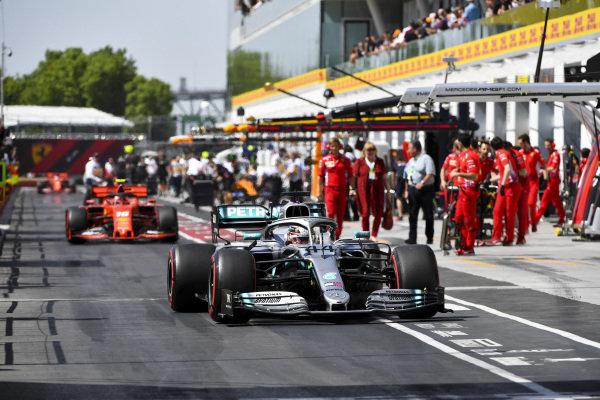 Lewis Hamilton, Mercedes AMG F1 W10 and Charles Leclerc, Ferrari SF90 drive through the pit lane to Parc Ferme