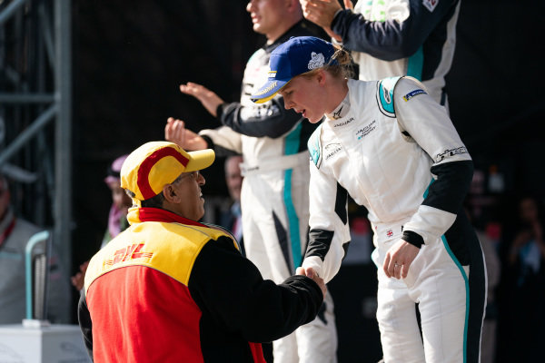 Alice Powell (GBR), Jaguar Ran Racing eTROPHY Team Germany, 3rd position, receives her trophy on the podium